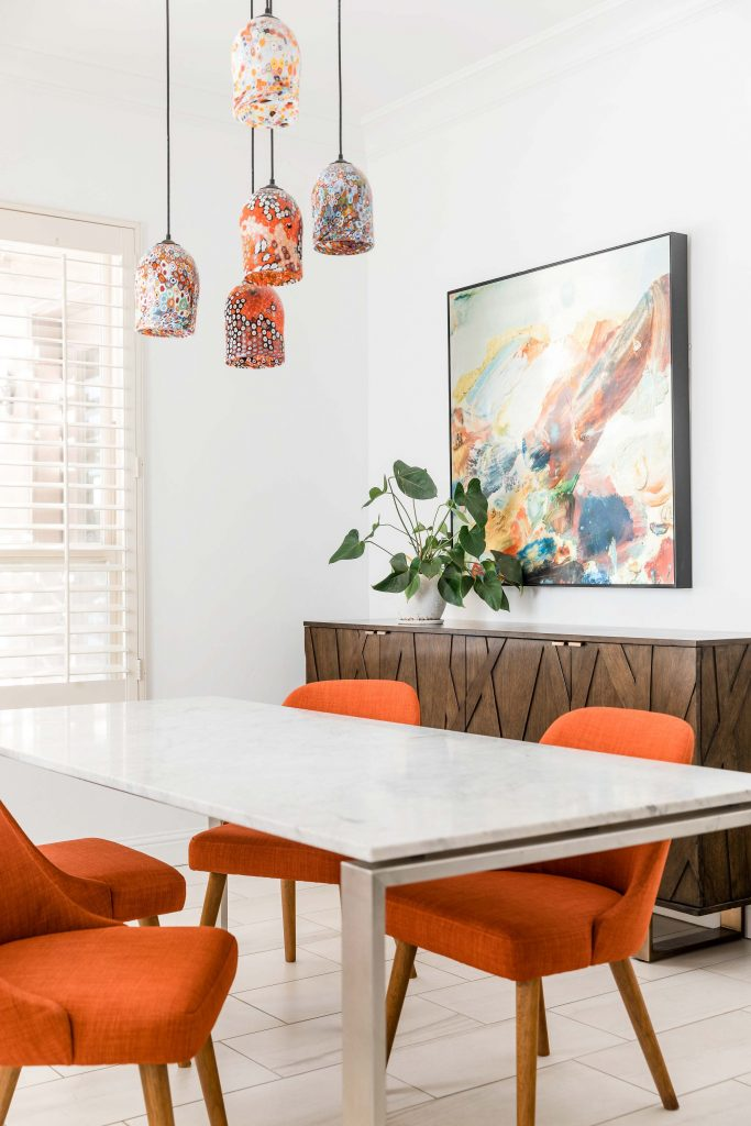 PepperJack Interiors Loomis California warm modern interior design light bright dining room with orange chairs