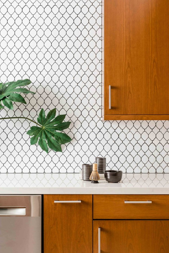 PepperJack Interiors Loomis California warm modern interior design kitchen tile backsplash detail white trellis design